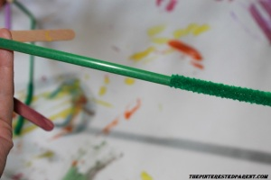 Insert a green pipe cleaner into the straw to add sturdiness & color.