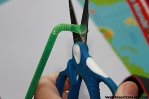 Trim the short end of a bendy straw so that there is about a 1/2 inch left before the bendy part of the straw.
