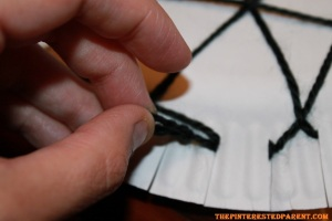 End your web at the same spot that you started it in. Tie the starting strand & end strand together,