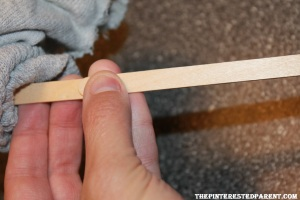 With a glue gun, glue a second stick to the first to lengthen your stick.