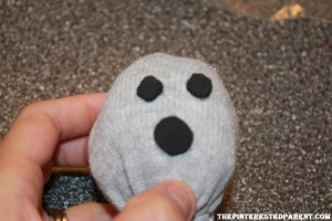Cut out two tiny foam circles for eyes & one larger circle for the mouth. Add googly eyes to the middle of the eyes.