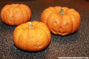 Draw out you pumpkin family's faces & then carefully carve out.