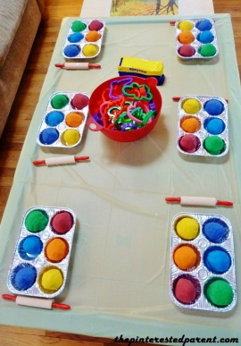 Our activity table had a rainbow collection of homemade Play-Doh for each party goer. Table included rolling pins, a bowl of cookie cutters & molds & Play-Doh presses.