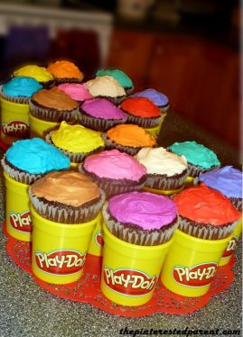 Multi-colored cupcakes fit perfectly inside of empty & clean Play-Doh containers.